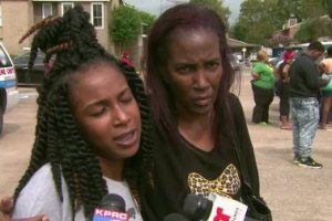 Smith's Sister (Left) speaks to the press.