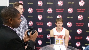 Kyle Korver talks to the media.