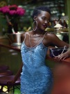 Luminous: The Non-Stop star's radiant complexion gleamed as she posed in a breathtaking ornate blue-petaled gown from Givenchy, but her exotic beauty wasn't always embraced