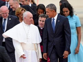 Pope Francis talks with President Barack Obama, accompanied by first lady Michelle Obama, after arriving at Andrews Air Force Base in Md., Tuesday, Sept. 22, 2015. The Pope is spending three days in Washington before heading to New York and Philadelphia. This is the Pope's first visit to the United States. (AP Photo/Susan Walsh)