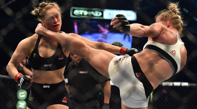 The Aftermath: Rousey Hides Face As She Returns Home