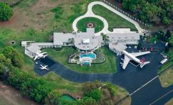 Travolta's house it probably one of the most unique celebrity homes out there. It cost a mere 2.7 million but has its own air plane runway for Travolta to park his many planes. The runway is so large it can actually fit his own private Boeing 707.