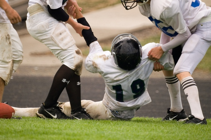 New Research Highlights Youth Football Players' Brain Injury Risk