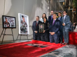 Selena Quintanilla is posthumously honored with star on the Hollywood Walk of Fame in Los Angeles, Nov. 3, 2017. Pictured are Leron Gubler, Eva Longoria, Suzette Quintanilla, Eric Garcetti, Victor Gonzalez, Otto Padron and guest.