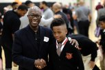 47E85E9C00000578-5247543-This_young_man_is_seen_shaking_hands_with_one_of_the_mentors_of_-a-164_1515449246653