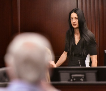 Rayne Perrywinkle looks at defendant Donald Smith as she takes the witness stand Monday, Feb. 12, 2018, at the Duval County Courthouse in Jacksonville, Fla., on the opening day of Smith's murder trial of Perrywinkle's daughter, Cherish Perrywinkle, in 2013.(Will Dickey/The Florida Times-Union via AP, Pool)