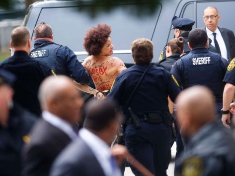 cosby-protest-topless-gty-ps-180409_hpMain_4x3_992