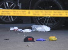Blood stained bandages and bullet casing on the ground outside The Marathon clothing store owned by Grammy-nominated rapper Nipsey Hussle where he was fatally shot along with 2 other wounded, in Los Angeles on March 31, 2019. - In addition to the man who was killed, the two other victims were listed as stable at a hospital, said police, who said a male suspect fled in a car. (Photo by Mark RALSTON / AFP)