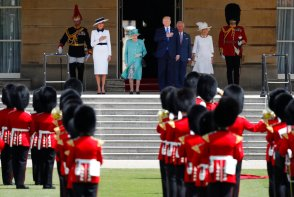 Britain's Queen Elizabeth II, President Donald Trump, first lady Melania Trump, Britain's Prince Charles and Camilla, Duchess of Cornwall, listen to the US national anthem during a ceremonial welcome in the garden of Buckingham Palace in London, Monday, June 3, 2019 on the opening day of a three day state visit to Britain. (AP Photo/Frank Augstein)