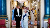 President Donald Trump and first lady Melania Trump walk with Queen Elizabeth II, followed by first lady Melania Trump, Prince Charles, and Camilla, Duchess of Cornwall, as they make their way into the Music Room for a State Banquet at Buckingham Palace, Monday, June 3, 2019, in London. (Doug Mills/Pool Photo via AP)